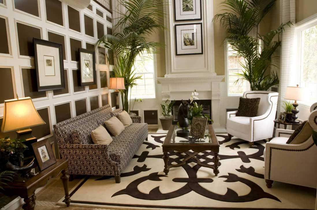 area rugs in living room with brown sofa also with white and brown chairs